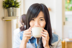 Woman with cup of coffee smiling in cafe stock images