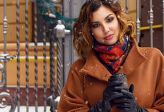 Woman with cup of coffee walk on snow street Christmas New Year Stock Photography
