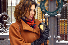 Woman with cup of coffee walk on snow street Christmas New Year Royalty Free Stock Photo