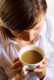 Woman with cup of coffee with wilk Royalty Free Stock Image