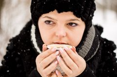 Woman with cup of coffee in the winter park Royalty Free Stock Photos