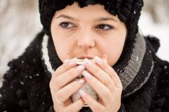 Woman with cup of coffee in the winter park Stock Image