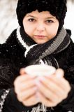 Woman with cup of coffee in the winter park Royalty Free Stock Photo