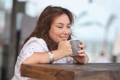 woman with a cup of drink Royalty Free Stock Photo