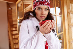 Woman with cup of hot chocolate on mountain ski resort Stock Photography