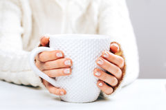Woman with cup of hot coffee Stock Images