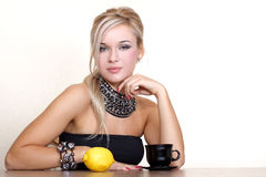 Woman with cup of hot drink with lemon Royalty Free Stock Photo