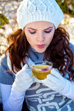 Woman with cup of hot herbal tea in hand Stock Photo