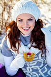 Woman with cup of hot herbal tea Royalty Free Stock Images