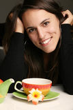 Woman  with a cup of hot tea Stock Images