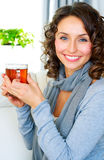 Woman with cup of hot tea. Beautiful Young Woman drinking healthy hot tea Royalty Free Stock Photography