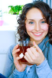 Woman with cup of hot tea Stock Photo