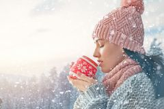 Woman with a cup of hot tea Stock Photography