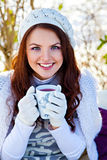 Woman with cup of hot tea in winter outdoors Royalty Free Stock Photography