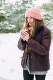 Woman with cup of hot tea in woolen hat Stock Photography