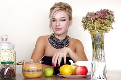 Woman with cup, jasmin petals, lemon, apple, tea Royalty Free Stock Photography