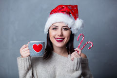 Woman with cup and lollipop Royalty Free Stock Photography