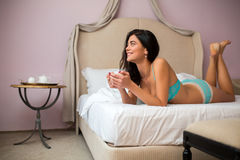 Woman with a cup lying. Royalty Free Stock Photography