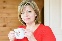 Woman with a cup Royalty Free Stock Photography