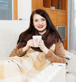 Woman  with cup near  electric heater Royalty Free Stock Photo