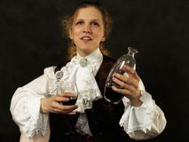 Woman with cup of red wine Stock Photos