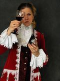 Woman with cup of red wine Stock Image