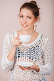 Woman with cup and saucer Royalty Free Stock Photos