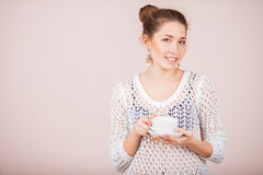 Woman with cup and saucer Royalty Free Stock Photography