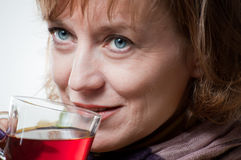 Woman with a cup tea Royalty Free Stock Images