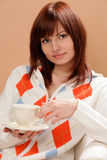 Woman drinking cup of tea Royalty Free Stock Photography