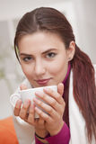 Woman with cup tea Stock Images