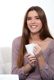 Woman with a cup of tea. A woman with a cup of tea Stock Photo