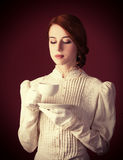 Woman with cup of tea Royalty Free Stock Images