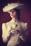 Woman with cup of tea Stock Photos