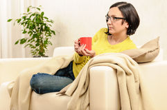 Woman cup of tea coffee watching tv Royalty Free Stock Image