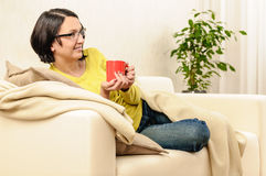 Woman cup tea coffee watching tv Stock Photo