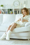 Woman with a cup of tea Royalty Free Stock Image