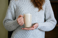 Woman with cup of tea in hands Royalty Free Stock Photos