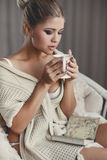 Woman with a cup of tea in his hands Stock Photography