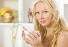 Woman with cup tea at home Stock Photos