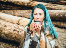 Woman with cup of tea outdoor Stock Photo