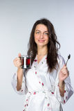 Woman with cup of tea  in peignoir early morning Royalty Free Stock Photos