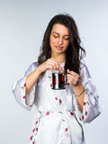 Woman with cup of tea  in peignoir early morning Stock Images