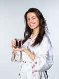 Woman with cup of tea  in peignoir early morning Stock Image