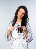Woman with cup of tea  in peignoir early morning Royalty Free Stock Photo