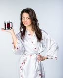 Woman with cup of tea  in peignoir early morning Stock Photography