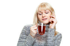 Woman with cup of tea and phone Royalty Free Stock Images
