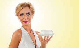Woman with cup of tea Stock Photography