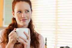Woman with a cup in thoughts Royalty Free Stock Photo