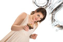 Woman with a cupcake. At her 30th birthday Stock Image